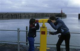 Philip Drew and Jonothan Yelland observing one another at Watchet harbour